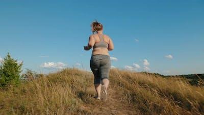 Overweight Girl Runs Up the Hill
