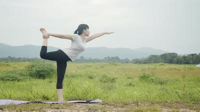 Young Asian caucasian woman performing a spiritual yoga meditation pose position yoga.