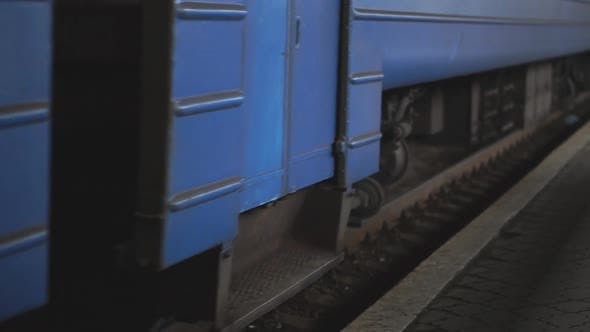Thumbnail for Passenger Railway Transport Passes By a Camera and Arrives at Station. Close Up Spinning Steel