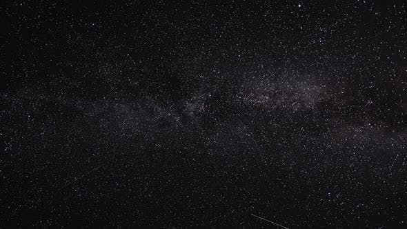 Thumbnail for Night Sky with Stars, Satellites. Milky Way Passing in Long Exposure Timelapse. Beautiful Panorama