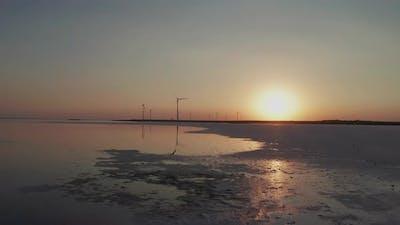 Wind Turbines on the Seashore at Sunset