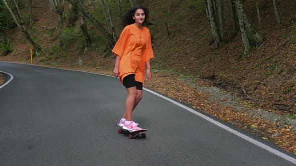 Sporty Girl Skateboarding in the Park