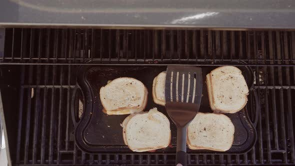 Thumbnail for Time lapse. Cooking grilled cheese sandwich on outdoor gas grill