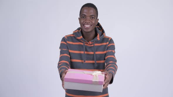 Thumbnail for Young Happy African Man Giving Gift Box