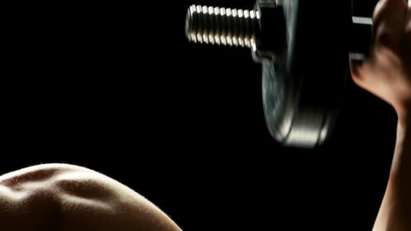 Close Up of Mans Biceps, Lifting Dumbbell.