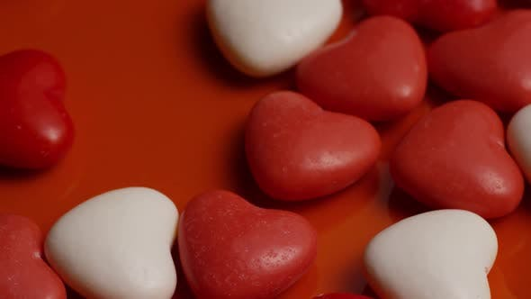 Rotating stock footage shot of Valentines decorations and candies - VALENTINES 0055