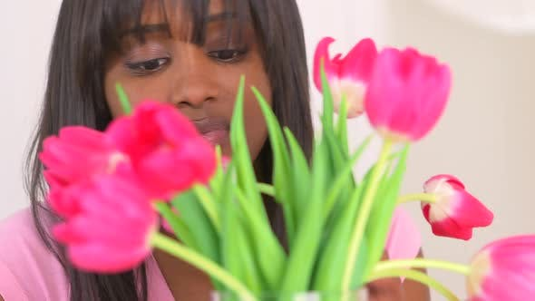 Thumbnail for Happy black woman arranging flowers