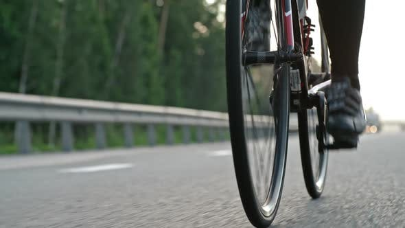 Thumbnail for Female Cyclist Riding along Highway