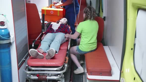 Thumbnail for Injured Woman Lie on Strecher in Ambulcanse Car.
