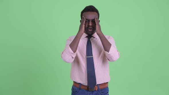 Thumbnail for Stressed Young African Businessman Having Headache