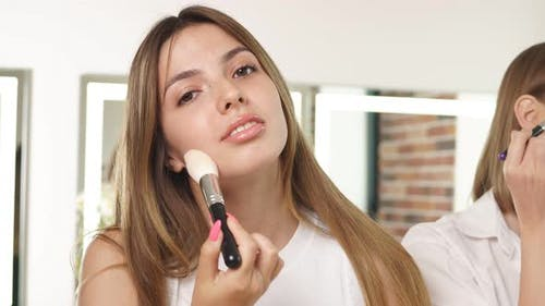Attractive Girl Applying Cosmetics on Face, Doing Make-up on Themselves