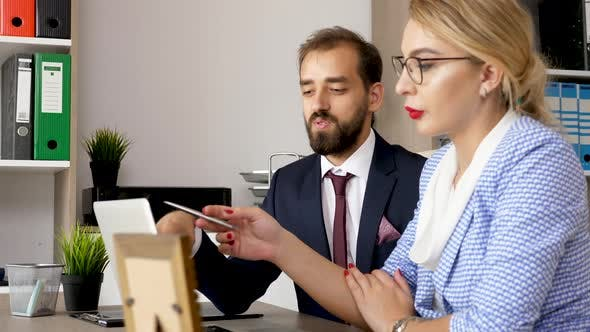 Thumbnail for Business Partners Talking in Front of Computer Screen