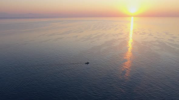 Cover Image for Aerial View Boat At Dawn At Sea Turkey