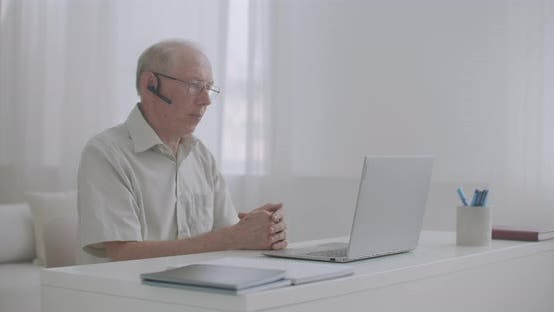 Thumbnail for Elderly Retiree Man Is Consulting By Internet with Specialist, Speaking and Gesticulating, Looking