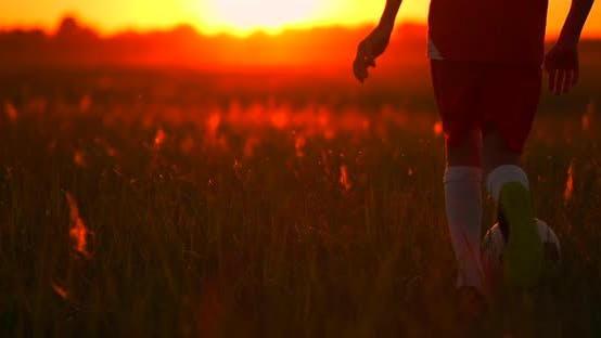 Thumbnail for Feet Boy Football Player Running at Sunset with a Ball