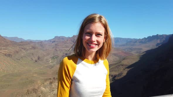Beautiful Blonde Model Smiling with the Gran Canaria Valley in Her Background