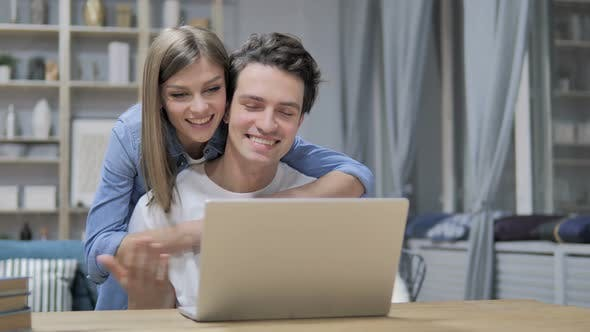 Thumbnail for Online Video Chat By Happy Young Couple at Home