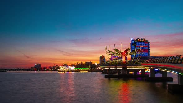 Thumbnail for Time lapse: Vietnam Can Tho city skyline boats on Mekong River, pedestrian walkaway waterfront