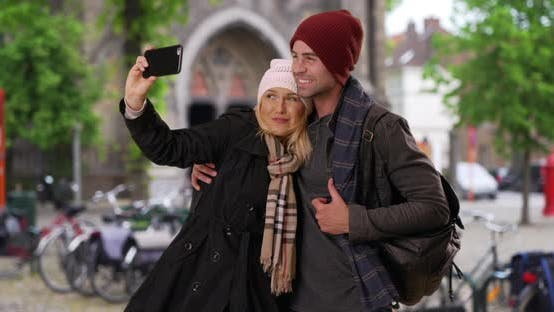 Thumbnail for Happy young couple taking a selfie with smartphone