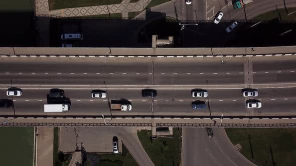 Cover Image for Drone's Eye View Car Aerial View of Urban Traffic Jam on a Car Bridge