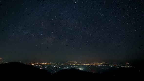 Thumbnail for Milky Way And Night Sky With Mountain Town