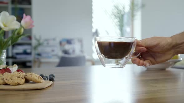 Thumbnail for Hand Taking Cup Of Coffee And Placing It Back