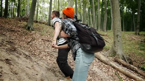 Couple Going Uphill in Forest