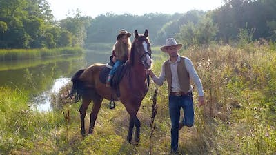 Cowboy and His Daughter on Horseback