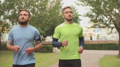 Twin Athletes Jogging
