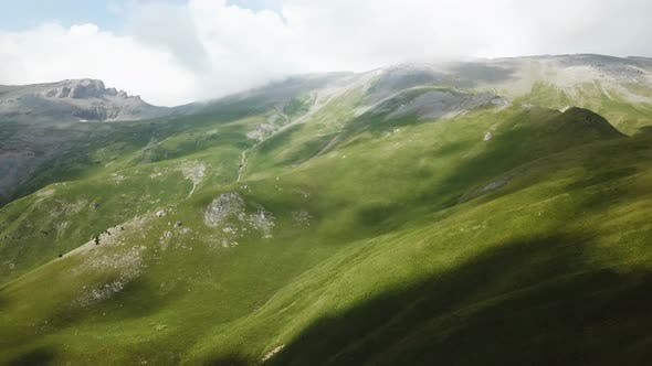 Thumbnail for Flight Over A Green Grassy Rocky Hills