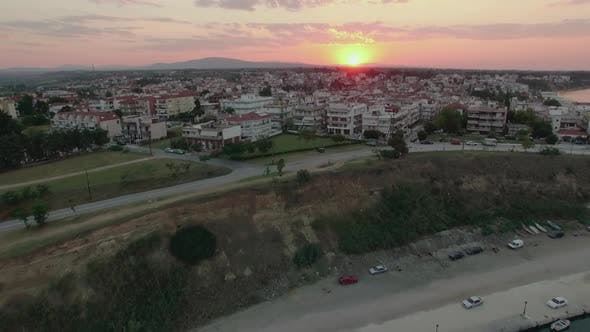 Thumbnail for Flying Over the Quay and House Roofs at Sunset. Nea Kallikratia, Greece