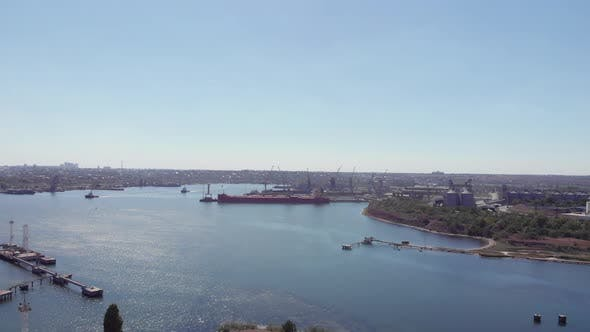 Aerial drone view of Black Sea Port with metals containers, high cranes and ships