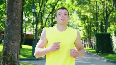 Man Taking Break in Jogging in Park