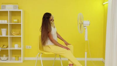 Sexy Woman With Long Hair Is Posing On Chair