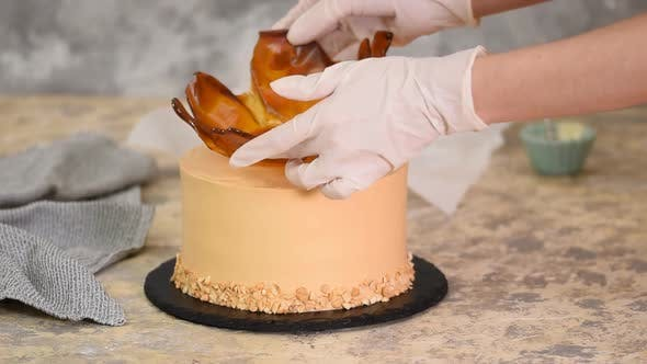Thumbnail for Pastry Chef Decorating the Cake with a Caramel Vase