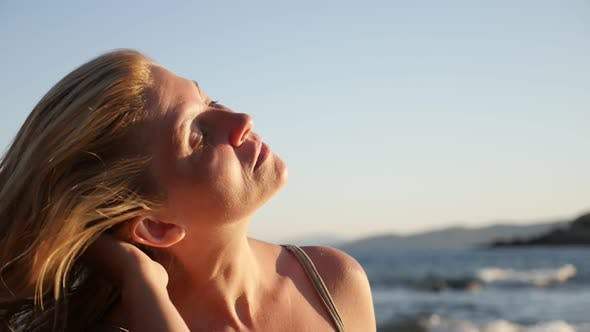 Thumbnail for Close-up of beautiful blond female by the sea    slow-mo 1920X1080 HD footage - Slow motion of enjoy