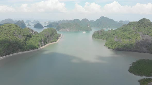 Aerial: unique flying over Ha Long Bay and Cat Ba island, famous tourism destination in Vietnam