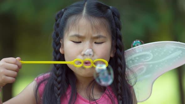 Thumbnail for Girl in fairy princess costume blowing bubbles, shot on Phantom Flex 4K