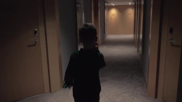 Thumbnail for Child Walking in Hotel Hall and Opening Room Door with Keycard