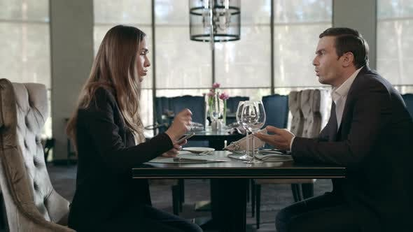 Thumbnail for Business Man and Woman Talking in Restaurant. Businessman and Businesswoman