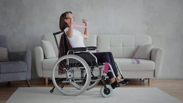 Thumbnail for Disabled woman is exercising at home