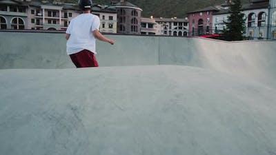 Skateboarder Training in Bowl Ramp