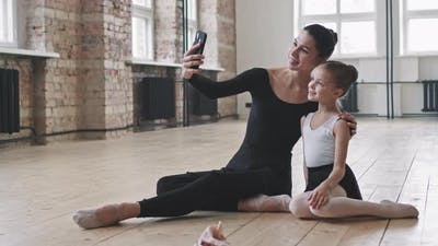 Adult And Little Ballerinas Taking Selfie
