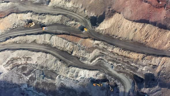 Huge Belaz Trucks Driving on the Pit Bottom in Mining Factory, Mine Quarry in Ukraine