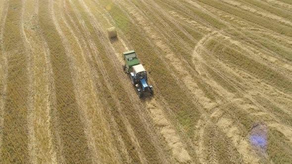 Aerial Dron Footage of Tractor Hay Harvesting