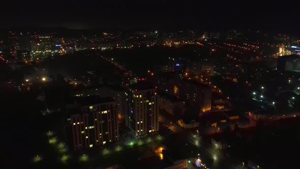 Flight Over the Night City and the House That Glows at Night