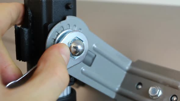 Thumbnail for Close-Up of Hands Tightening Nut Fastener with A Hexagonal Ratchet Wrench