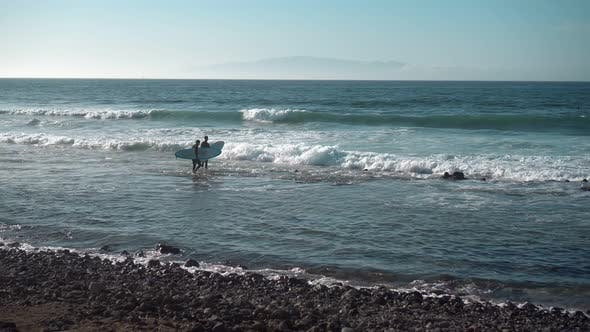 Thumbnail for Surfers on Ocean Coast