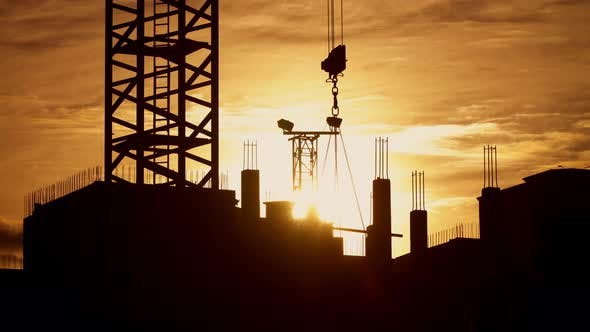 Thumbnail for Tower Crane Working on Construction Site Elevate Steel Structures Weight Sunny Evening, Golden Hour