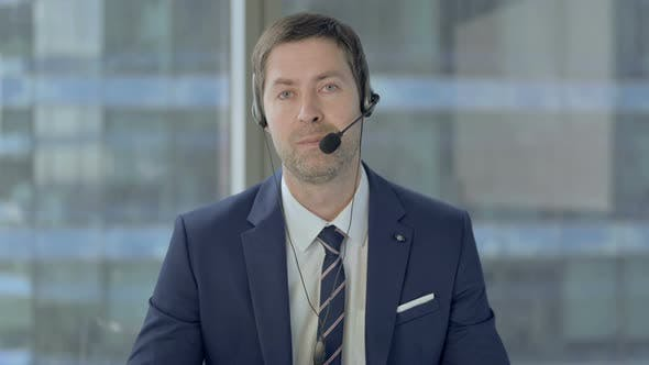 Thumbnail for Talking Middle Aged Businessman with Headset